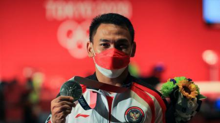Lifter senior Indonesia, Eko Yuli Irawan berhasil meraih medali perak di Olimpiade Tokyo 2020. - INDOSPORT