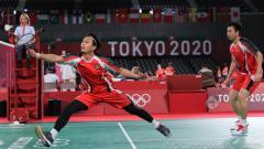 Indosport - Mohammad Ahsan/Hendra Setiawan berhasil menalukkan pasangan ganda Korea Selatan Choi Sol Gyu/Seo Seung Jae dengan skor 21-12, 19-21 dan 21-18.