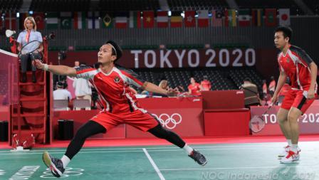 Hendra Setiawan/Mohammad Ahsan berhasil mengalahkan wakil Malaysia, Aaron Chia/Wooi Yik Soh di pertandingan kedua penyisihan Grup B Olimpiade Tokyo 2020.