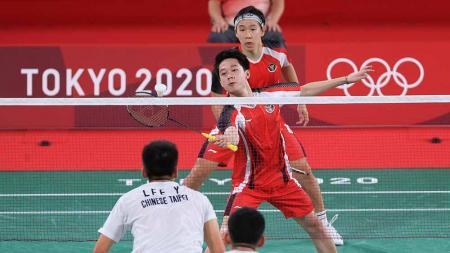 Atlet bulutangkis asal Malaysia, Aaron Chia, tak setuju ganda putra Indonesia, Kevin Sanjaya/Marcus Gideon diceraikan. - INDOSPORT