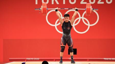Sukses raih perunggu di Olimpiade Tokyo, Rahmat Erwin Abdullah diminta fokus pikirkan karier oleh Menpora Zainudin Amali. - INDOSPORT
