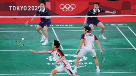 Marcus Fernaldi Gideon/Kevin Sanjaya Sukamuljo secara mengejutkan terhenti di babak perempat final Olimpiade Tokyo 2020. - INDOSPORT