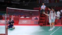 Indosport - Marcus Gideon/Kevin Sanjaya usai kalah di 8 besar Olimpiade 2020.
