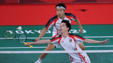 Marcus Gideon/Kevin Sanjaya usai kalah di 8 besar Olimpiade 2020. - INDOSPORT