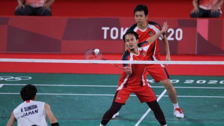 Pebulutangkis ganda putra Indonesia Hendra Setiawan/Mohammad Ahsan di Olimpiade Tokyo 2020. - INDOSPORT