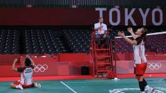 Indosport - Greysia Polii/Apriyani Rahayu sukses mengalahkan wakil China, Li Yunhui/Du Yue pada babak perempatfinal Olimpiade Tokyo, Kamis (29/07/21).
