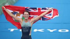 Indosport - Flora Duffy, atlet triathlon asal Bermuda yang raih emas Olimpiade Tokyo 2020.