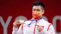 Indosport - Lyu Xiaojun, lifter asal China.