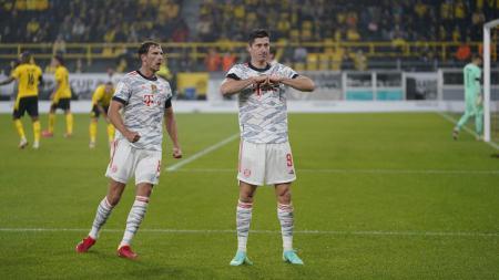 Striker Bayern Munchen, Robert Lewandowski (kanan) - INDOSPORT