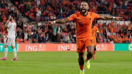 Memphis Depay merayakan gol di laga Kualifikasi Piala Dunia 2022 Belanda vs Montenegro - INDOSPORT