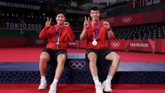 Indosport - Wang Yilyu dan Huang Dongping, pebulutangkis ganda campuran asal China langsung main di laga perdana Piala Sudirman 2021