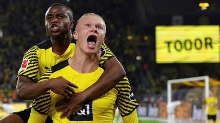 Borussia Dortmund, Erling Haaland, merayakan gol kemenangan ke gawang Bayer Leverkusen pada laga pekan keempat Bundesliga Jerman, Sabtu (11/09/21). - INDOSPORT