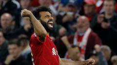 Indosport - Selebrasi gol Mohamed Salah di Liga Champions Liverpool vs AC Milan.