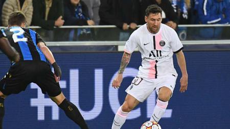 Aksi Lionel Messi di laga Club Brugge vs PSG dalam ajang Liga Champions. - INDOSPORT
