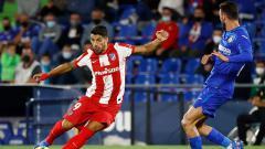 Indosport - Aksi Luis Suarez di laga LaLiga Spanyol Getafe vs Atletico Madrid.