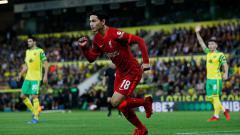 Indosport - Selebrasi gol Takumi Minamino di laga Norwich City vs Liverpool.