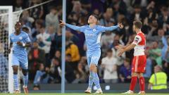 Indosport - Selebrasi gol Phil Foden di laga Manchester City vs Wycombe Wanderers.