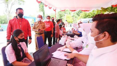 Mengawali kegiatan ekshibisi Esport Pekan Olahraga Nasional (PON) XX Papua 2021, PB Esport Indonesia (PBESI) melakukan aksi mulia untuk masyarakat Jayapura. - INDOSPORT