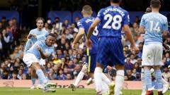 Indosport - Striker Gabriel Jesus mencetak gol kemenangan Manchester City atas Chelsea dalam pertandingan Liga Inggris, Sabtu (25/9/21).