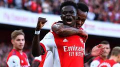 Indosport - Selebrasi gol Bukayo Saka di laga Arsenal vs Tottenham Hotspur.