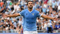 Indosport - Selebrasi gol Pedro di laga Lazio vs AS Roma dalam lanjutan Liga Italia.