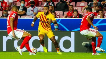 Barcelona resmi mencatatkan rekor terburuk sepanjang masa di Liga Champions, usai secara mengejutkan dibantai oleh Benfica. - INDOSPORT