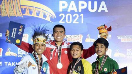 Pemain muda Persija Jakarta, Uchida Sudirman berhasil meraih prestasi di PON XX Papua, dengan mendapatkan dua medali untuk DKI Jakarta di cabor muaythai. - INDOSPORT