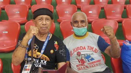 Euforia Pekan Olahraga Nasional (PON) edisi ke-20 turut dimeriahkan oleh laga eksebisi  legenda tinju asal Papua pada hari ini. - INDOSPORT