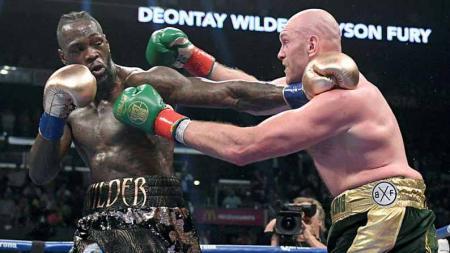 Berikut link live streaming duel tinju kelas berat antara Tyson Fury vs Deontay Wilder yang akan berlangsung pada hari ini, Minggu (10/10/21). - INDOSPORT