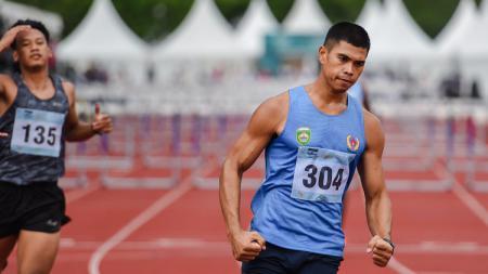 Atlet asal Sumatra Selatan, Rio Maholtra yang memecahkan rekor lari gawang 110 meter putra di PON XX Papua - INDOSPORT
