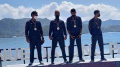 Indosport - Pedayung Jabar di nomor M4X putra meraih medali emas rowing PON XX Papua.