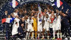 Indosport - Berhasil menyabet gelar juara UEFA Nations League tak membuat timnas Prancis langsung merangsek dan bertengger di urutan teratas daftar ranking FIFA terbaru.