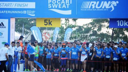 Guna menjaga kesehatan dan ritme olahraga selama pandemi, PT Amerta Indah Otsuka menggelar terobosan anyar, yakni Pocari Sweat Run Virtual 2020 pada 16 Agustus mendatang. - INDOSPORT
