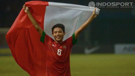 Evan Dimas pada saat selebrasi setelah U-19 mengalahkan Korsel pada penyisihan Grup G Piala AFC U-19 di SUGBK, Jakarta Sabtu (12/10/2013). - INDOSPORT