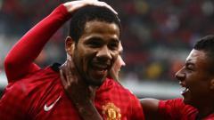 Indosport - Bebe kala berseragam Manchester United.