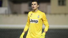Indosport - Emilio Audero, kiper muda Juventus yang dipinjamkan ke Venezia.