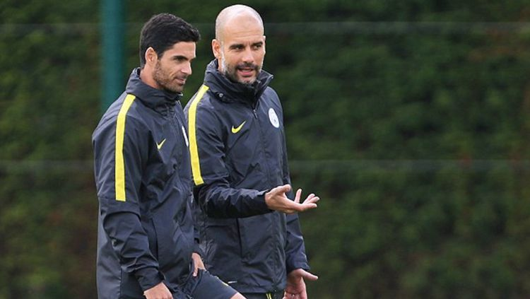 Mikel Arteta dan Pep Guardiola (Manchester City) Copyright: © Internet