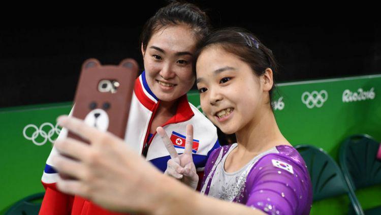 Kontingen atlet Korea Utara Copyright: © The Baltimore Sun Darkroom