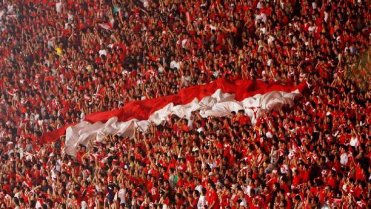 Ilustrasi suporter Tim Nasional Indonesia. Copyright: © INTERNET