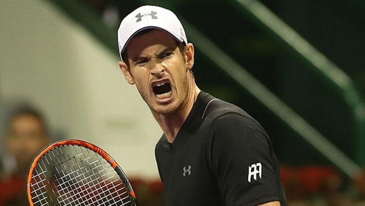 Andy Murray selebrasi dalam pertandingan ATP Qatar Open 2017. Copyright: KARIM JAAFAR/AFP/Getty Images