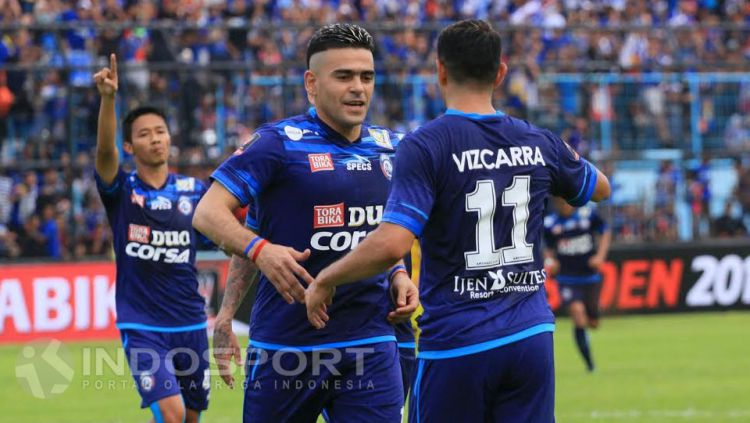 Esteban Vizcarra dan Cristian Gonzales, masih berpengaruh besar terhadap skema permainan Arema. Copyright: © Ian Setiawan/INDOSPORT