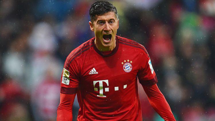Robert Lewandowski rayakan gol yang ia lesakkan ke gawang 1899 Hoffenheim di Allianz Arena tahun lalu. Copyright: © Matthias Hangst/Bongarts/Getty Images