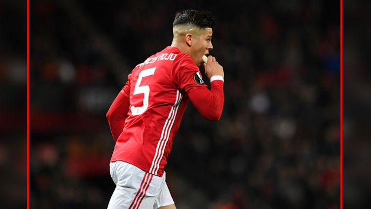 Pemain Manchester United, Marcos Rojo, kabarnya bakal hengkang pada Januari 2020. Copyright: © Stu Forster/GettyImages