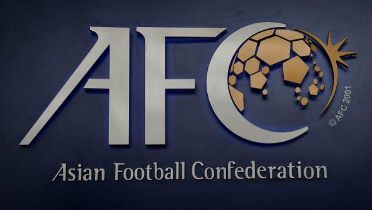 Federasi Sepak Bola Asia (AFC) desak Malaysia ikuti langkah PSSI soal gaji pemain di tengah pandemi virus corona. Copyright: © LILLIAN SUWANRUMPHA/AFP/Getty Images