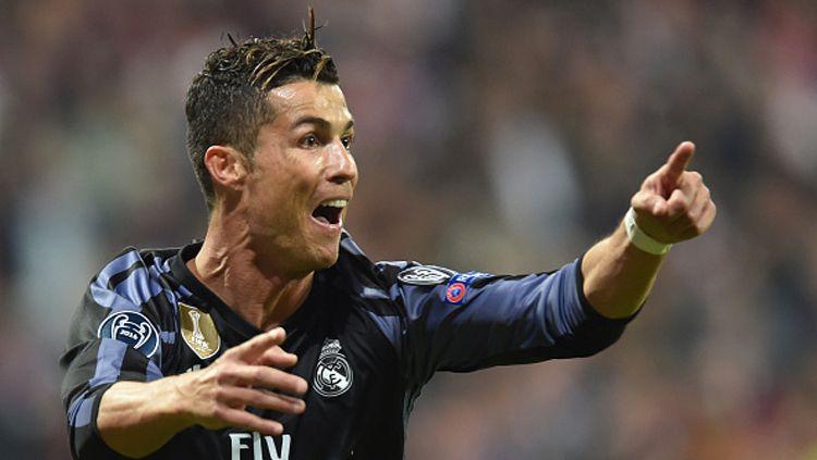 Tak adanya peran Cristiano Ronaldo lagi menjadi satu-satunya masalah raksasa LaLiga Spanyol, Real Madrid, ketimbang sibuk dengan rivalnya, Barcelona. Copyright: © CHRISTOF STACHE/AFP/Getty Images