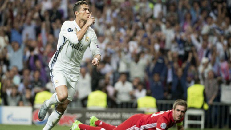 Ronaldo merayakan golnya ke gawang Bayern Munchen. Copyright: © CURTO DE LA TORRE / Stringer / Getty Images