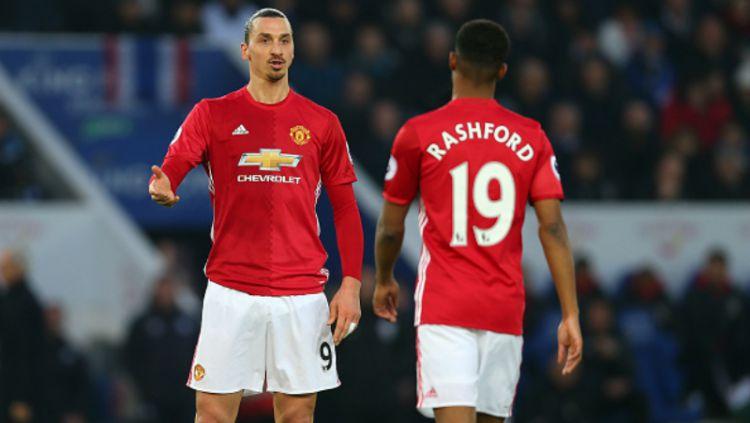 Zlatan Ibrahimovic (kiri) bersama dengan Marcus Rashford. Copyright: Catherine Ivill - AMA / Contributor / Getty Images