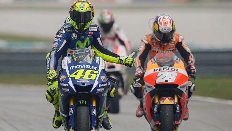 Rivalitas antara Valentino Rossi dan Dani Pedrosa di masa lampau tak membuat hubungan keduanya memburuk Copyright: © MOHD RASFAN/AFP/Getty Images