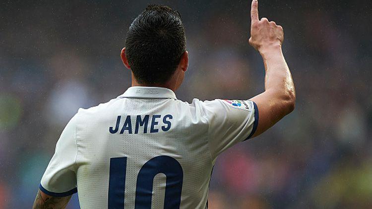 Pemain sepak bola Real Madrid, James Rodriguez, kabarnya tengah jadi rebutan dua raksasa Liga Inggris, yaitu Manchester United dan Tottenham Hotspur. Copyright: © fotopress/Getty Images