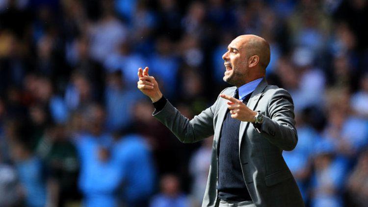 Pelatih Manchester City, Pep Guardiola. Copyright: © Richard Heathcote/Getty Images